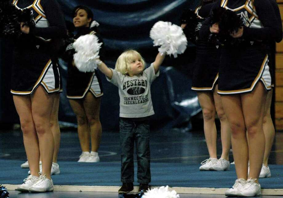 3 year-old Charlotte Bisaccia, joins in with the cheerleaders to show her enthusiam for the Western Connecticut State University Colonials at a basket ball game vs. UMass Dartmouth on Saturday, Jan. 29, 2011. Charlotte is the daughter of WCSU cheerleading coach, Debbie Bisaccia. Photo: Cathy Zuraw / Connecticut Post