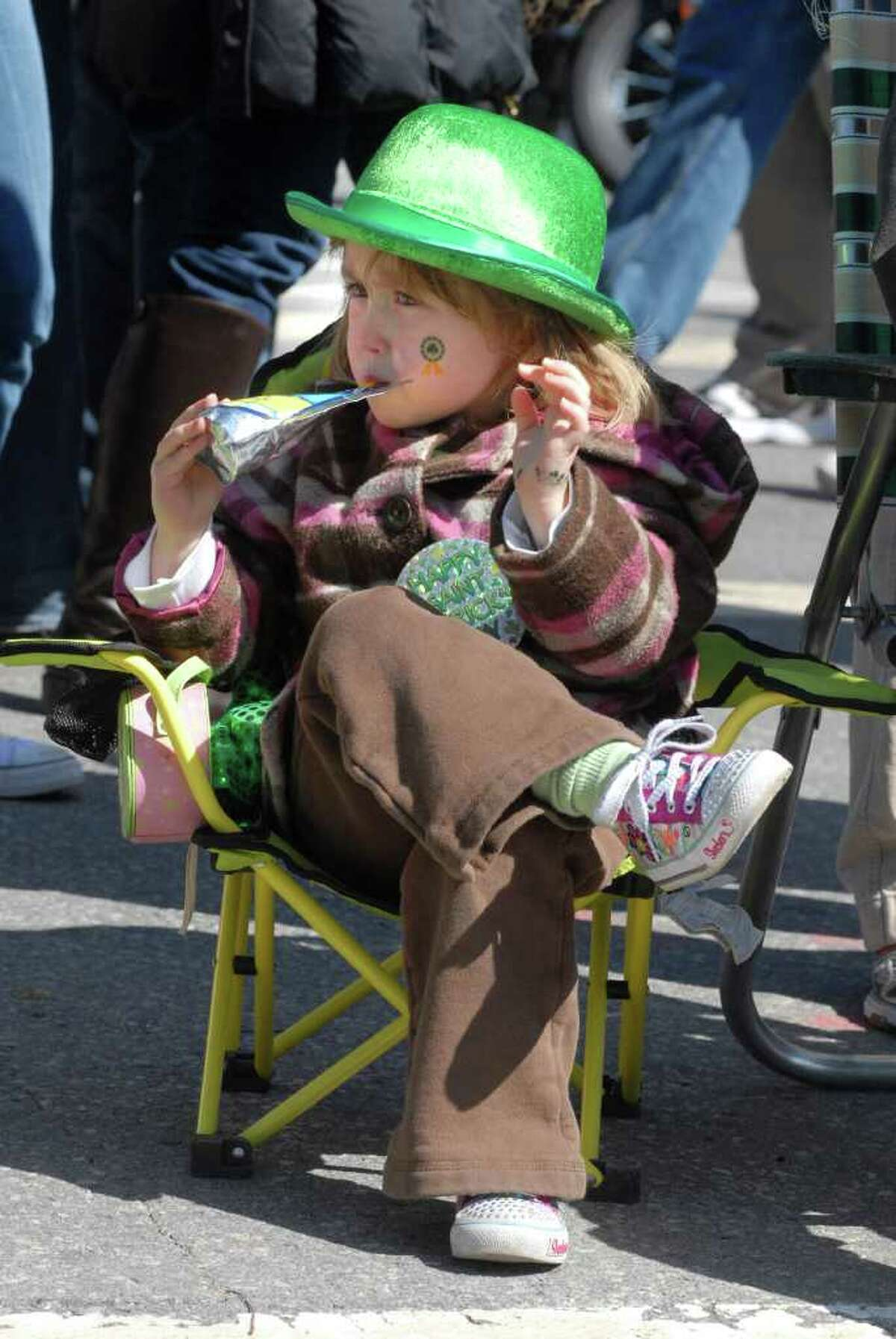 Riley Conetta (4) from Port Chester, NY watches the 35th annual St Patrick's Day Parade in Greenwich, Conn. on Sunday March 20, 2011.