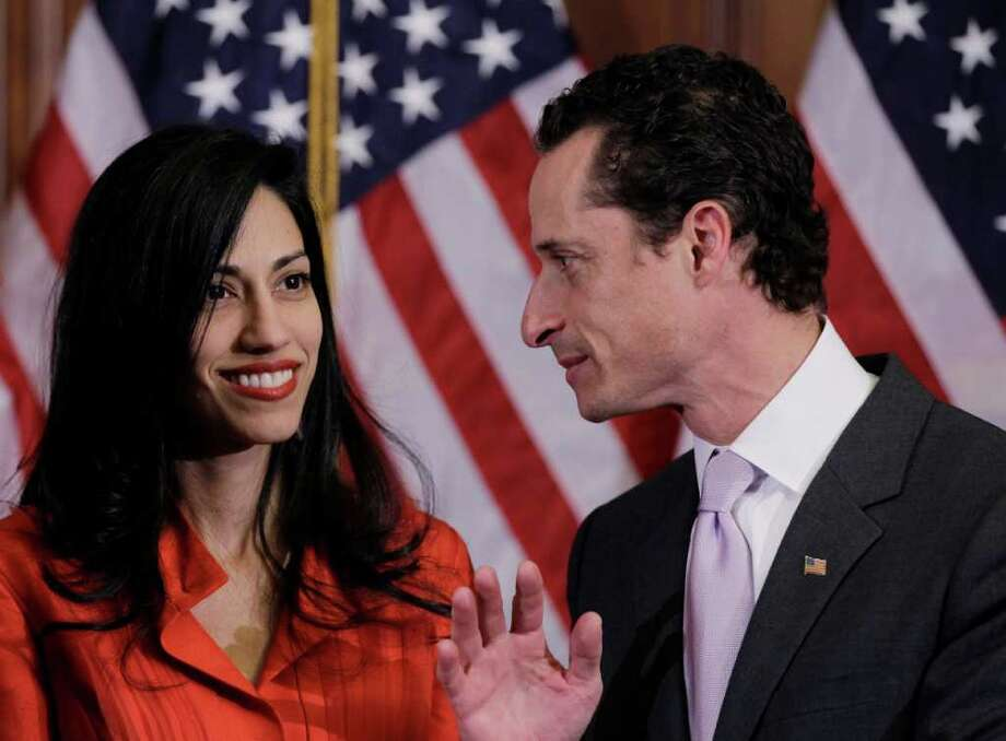 In this Jan. 5, 2011, file photo, Rep. Anthony Weiner, D-N.Y., and his wife, Huma Abedin, aide to Secretary of State Hillary Rodham Clinton, are pictured after a ceremonial swearing in of the 112th Congress on Capitol Hill in Washington.  (AP Photo archive/Charles Dharapak) Photo: Charles Dharapak / AP
