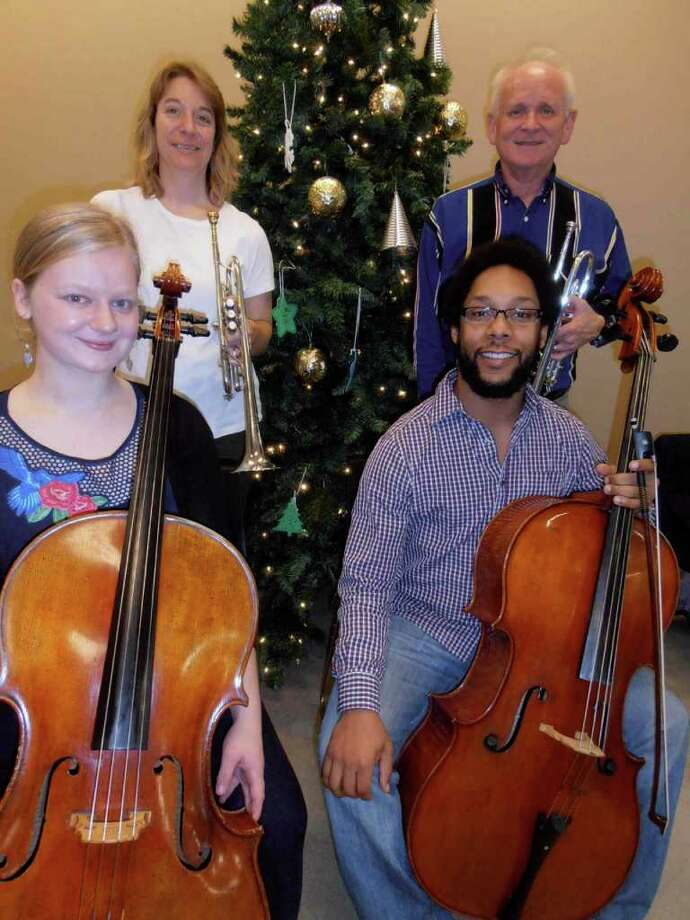 Trumpeters Lauren Eberhart and Jan Roller, at top, and cellists Morgen Johnson, bottom left, and Ryan Murphy were among 19 San Antonio Symphony members and guest musicians who played during lunch at Haven for Hope, Dec. 19. Photo: Nancy Cook-Monroe, For The Express-News