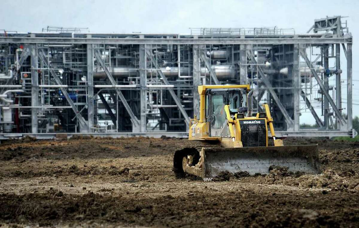 Workers clear land to prepare for more equipment moving in for the expansion at Motiva in Port Arthur, Thursday. Tammy McKinley, The Enterprise