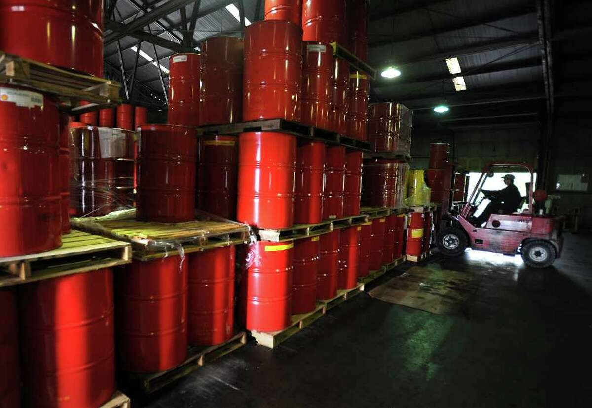 Will Spidle hauls a load of synthetic compressor oil at Spidle Oil Co. on Wednesday to be sold to Motiva. Motiva owned the product in a less refined state who then sold it to Shell who then sold a more refined product to Spidle. Guiseppe Barranco/The Enterprise