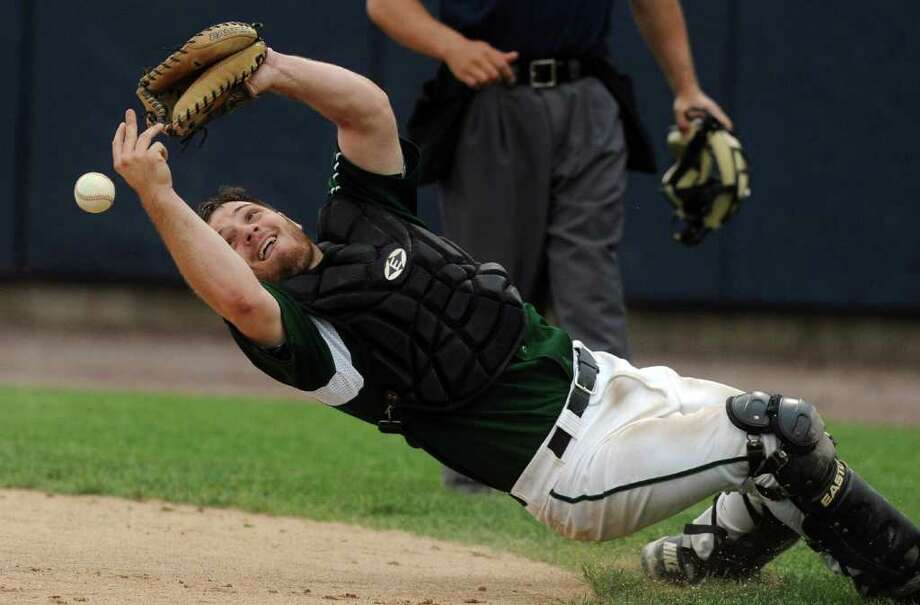 Norwalk's Kevin Daniele misses the ball as he leans backwards to try to catch it during Thursday's FCIAC semifinal game at the Arena at Harbor Yard on May 26, 2011. Photo: Lindsay Niegelberg / Stamford Advocate