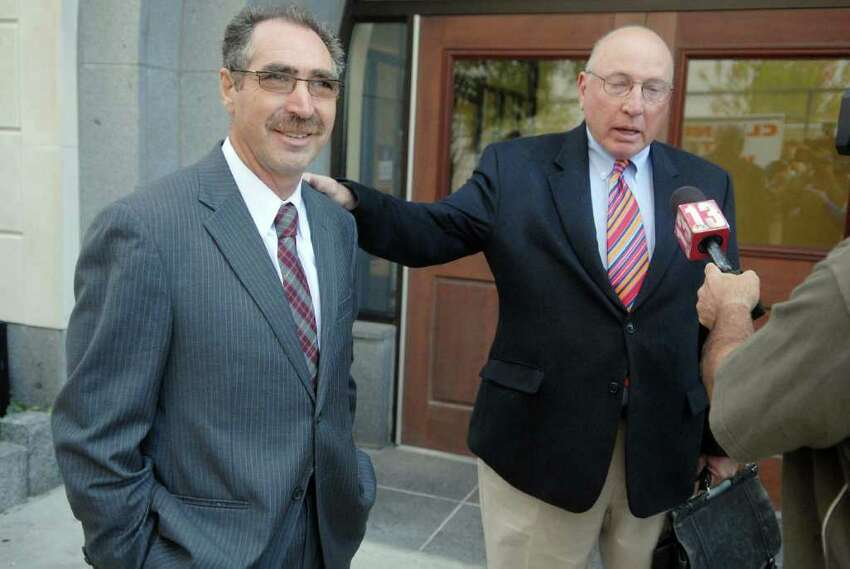 Troy City Councilman Michael LoPorto, left, and his attorney, Michael Feit, right, talk with the media following a hearing in front of Judge Stephen Herrick at the Albany County Judicial Center in Albany, NY on Tuesday, Sept. 14, 2010 pertaining to the case of ballot-fraud in Troy. During the hearing lawyers made arguments on the special prosecutor?s attempt to get a search warrant to collect DNA from LoPorto and the city clerk. (Paul Buckowski / Times Union)
