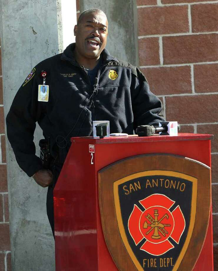 The San Antonio Fire Department and Chief Charles Hood reminds San Antonians about fire safety during the Christmas holiday with a mock fire of a Christmas tree at the department's training facility on Thursday, Dec. 22, 2011. Chief Hood reminded residents to keep live trees well watered, don't use ovens as heaters, test smoke detectors and have an escape plan in case of fire. Though fires from trees were rare last year in San Antonio, Chief Hood noted that fire deaths, injuries and dollar loss increased an average of 51 percent between December 24th and 26th according to U.S. Fire Administration. Photo: Kin Man Hui, ~ / San Antonio Express-News