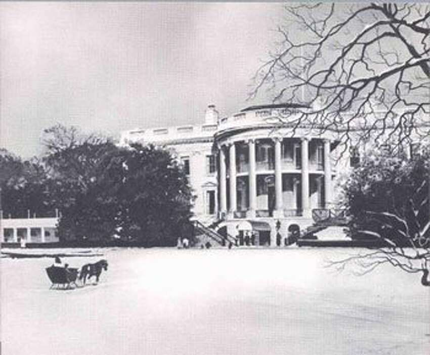 John F. Kennedy 1962. Nothing but a sleigh and another spare, almost depressing image of the White House.