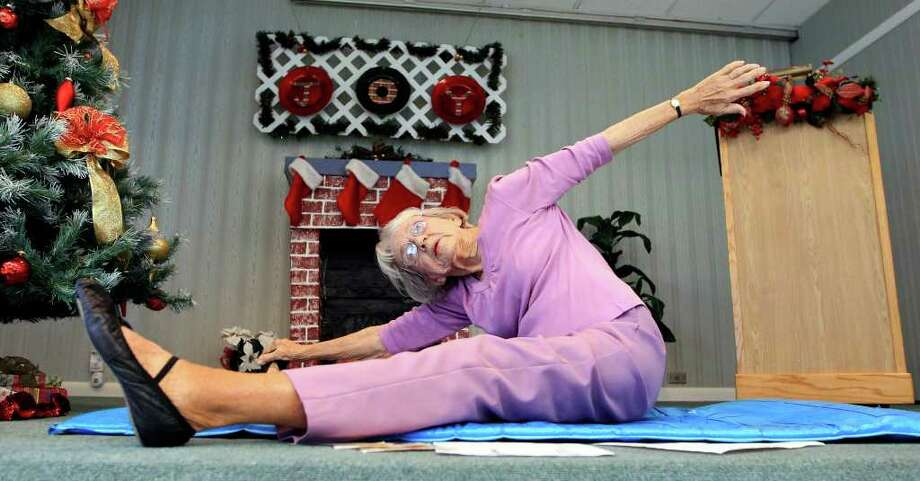 In this Dec. 14,  2011 photo, 92-year-old Bernice Bates teaches her weekly yoga class at the Mainlands Retirement Community Center in Pinellas Park, Fla. Bates is the world?s oldest yoga teacher, according to the Guinness Book of World Records. (AP Photo/Chris O'Meara) Photo: Chris O'Meara / AP