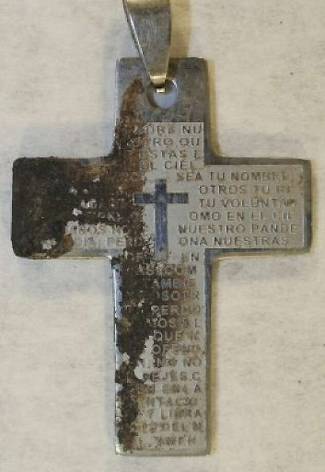 This cross was found with an unidentified woman's remains. Authorities hope someone will see it and come forward with information. Photo: Harris County Medical Examiner