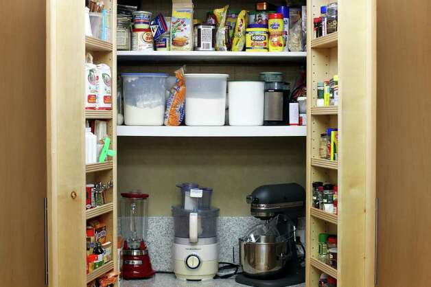 The built in baking pantry in the kitchen of Sue and Jim Ewers, Friday, December 16, 2011. Photo: JENNIFER WHITNEY, Jennifer Whitney/ Special To The Express-News / special to the Express-News