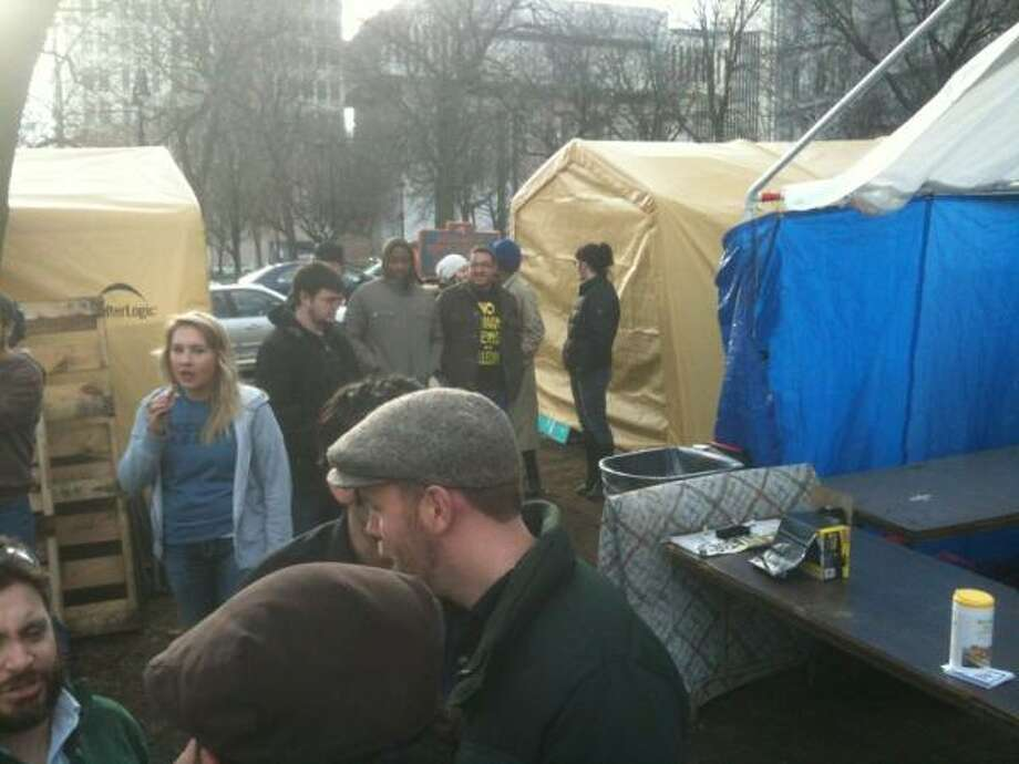 Albany workers dismantle the Occupy Albany site in Academy Park. (Casey Seiler/Times Union )