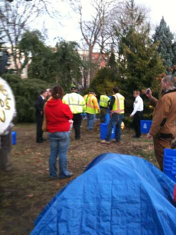 Albany workers take down the Occupy Albany encampment in Academy Park in Albany on Thursday. (Bryan Fitzgerald / Times Union)