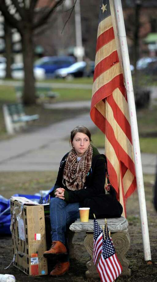 Emily Breunig of North Adams, Mass., and a member of the Occupy movement watches as members of the Albany Department of General Services remove the tents and anything related to the encampment of Occupy Albany from Academy Park in Albany, N.Y. Dec. 22, 2011.     (Skip Dickstein / Times Union) Photo: SKIP DICKSTEIN