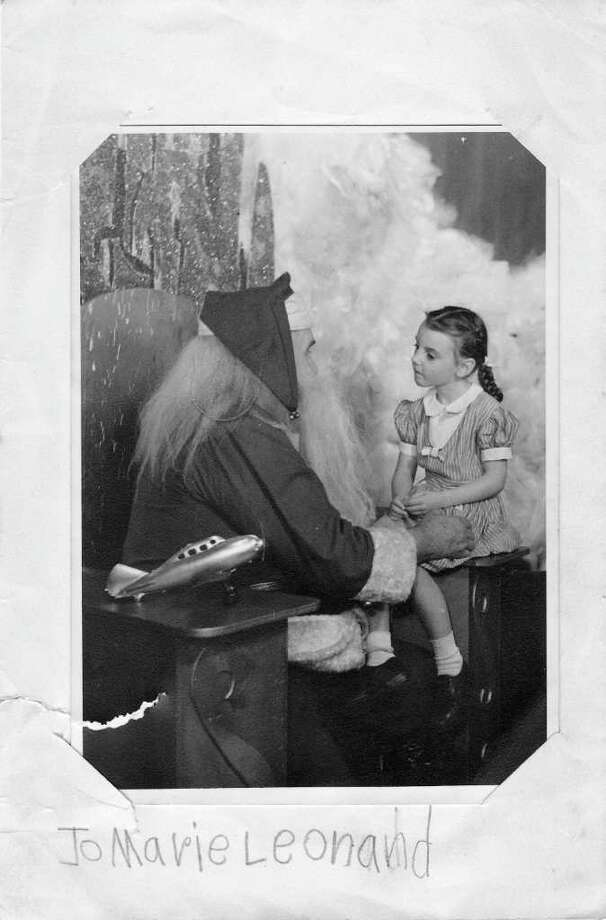 Jo Marie Leonard, 6, poses with Santa Claus at Joske's Toyland during Christmas 1946. The photo of Jo Marie, now Jodie McMahon, was proudly submitted by her husband of nearly half a century, Stephen McMahon. Photo: Courtesy, Stephen McMahon