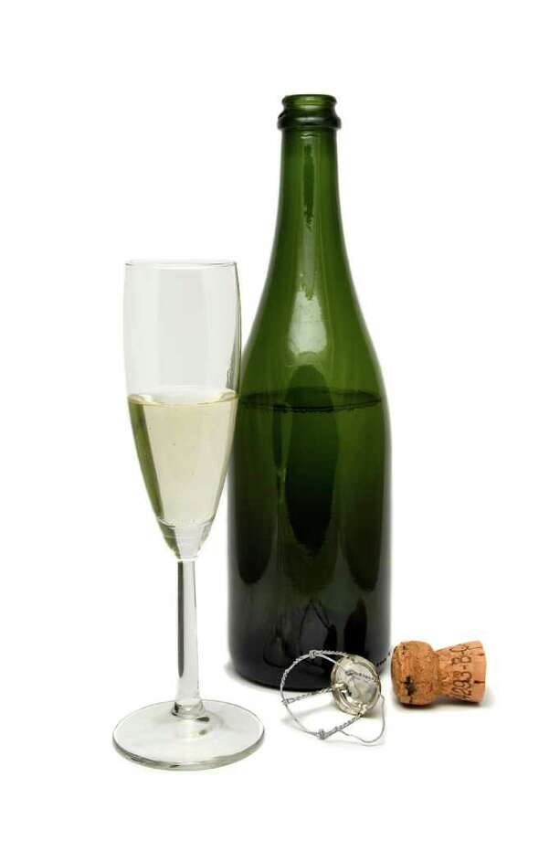 Champagne bottle and flute. Photo: Courtesy