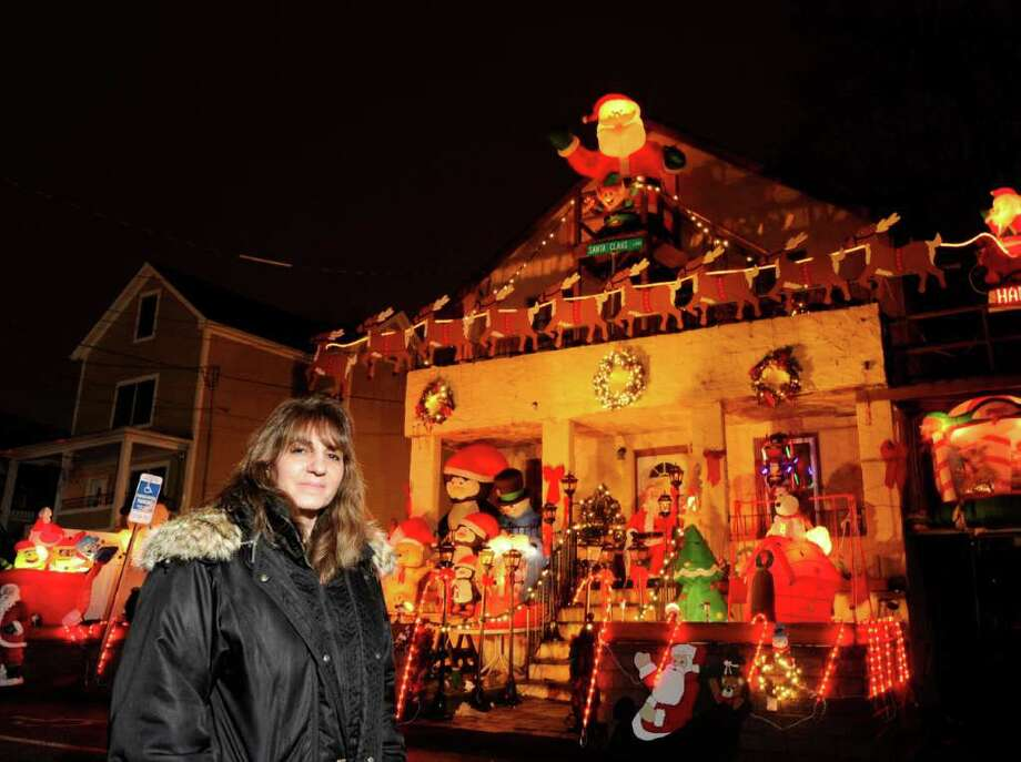 Darlene Church stands in front of the Christmas display at her home at 33 Harold Ave., Chickahominy, Wednesday night, Dec. 21, 2011. Photo: Bob Luckey / Greenwich Time