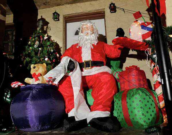The Christmas display at the home of Darlene Church includes a mechanical Santa that opens his mailbox, at 33 Harold Ave., Chickahominy, Wednesday night, Dec. 21, 2011. Photo: Bob Luckey / Greenwich Time