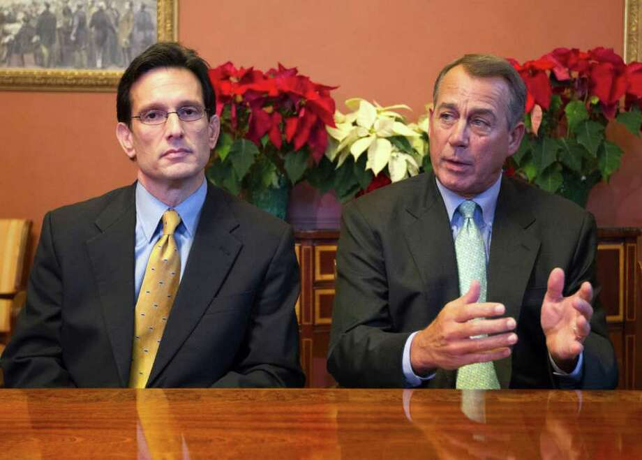Speaker of the House Rep. John Boehner, R-Ohio (right), and House Majority Leader Rep. Eric Cantor, R-Va., meet with the conference committee on the payroll tax cut. Photo: Associated Press, Evan Vucci