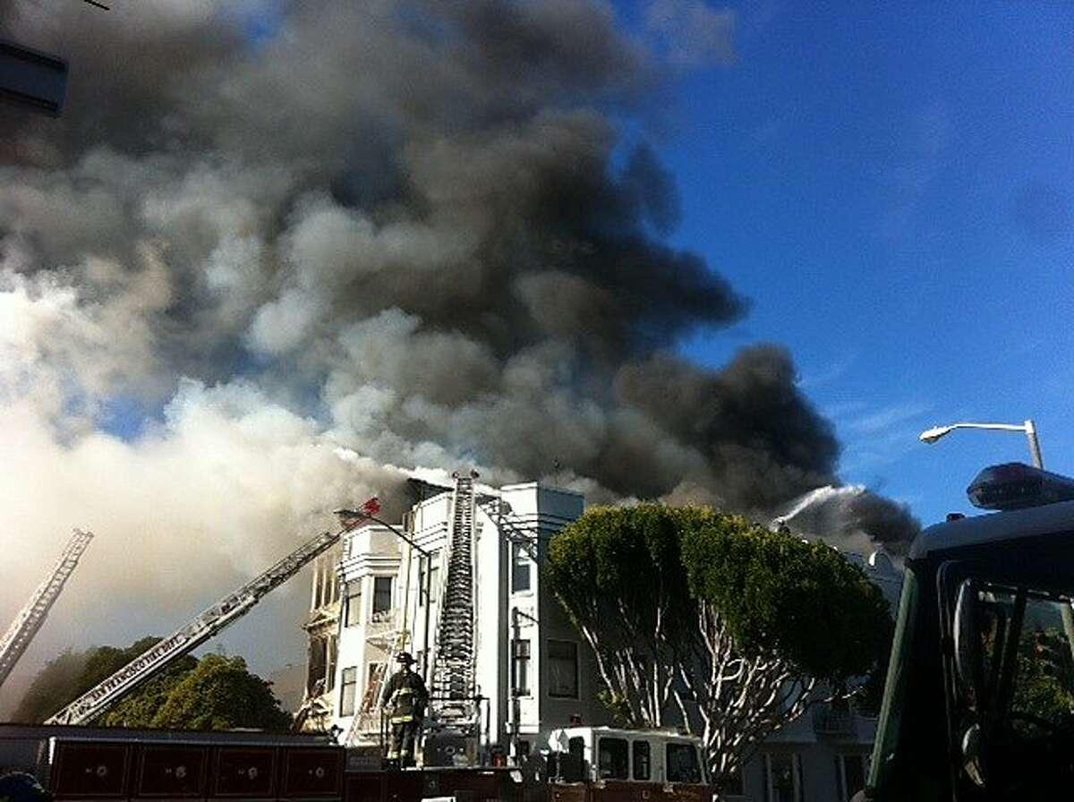 Smoke rises from a five alarm fire at 1100 Elm Street near San Francisco's Alamo Square.