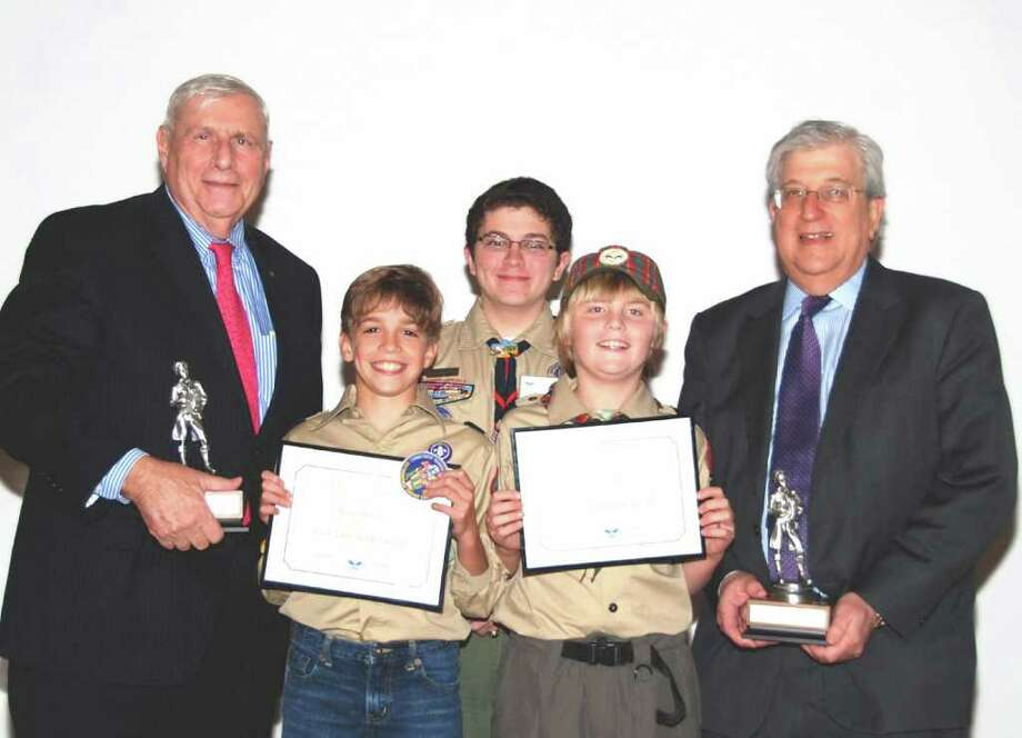 Honorees Joe Rucci, left, and Jay Forgotson, right, with Scout Speakers Aidan Orr and Julian Matrullo from Stamford Pack 11 and, behind, Master of Ceremonies Eagle Scout Sean Nulty. Photo: Contributed Photo