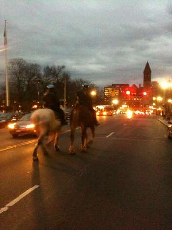 Albany police mounted officers guide their horses ahead of Occupy Albany protesters on Thursday, Dec. 22, 2011. (Bryan Fitzgerald/Times Union)