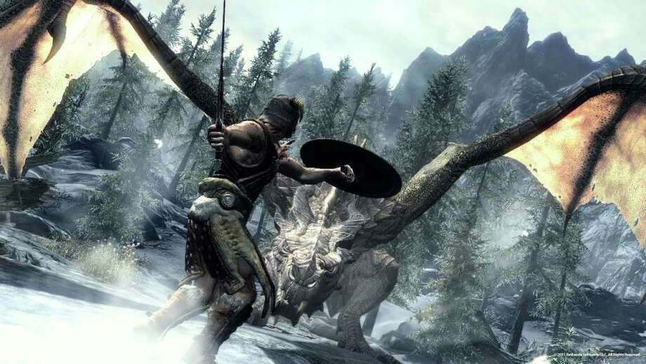 """In this video game image released by Bethesda Softworks, a Dragonborn hero battles one of the flying lizards in """"The Elder Scrolls V: Skyrim."""" (AP Photo/Bethesda Softworks) Photo: Anonymous"""