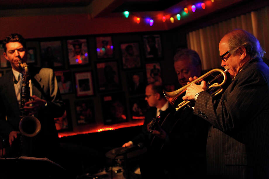 Jim Cullum, of The Jim Cullum Jazz Band, plays with Evan Arntzen, left, on the clarinet and at Tucker's Kozy Korner on Tuesday, Nov. 29, 2011. Also playing are Benji Bohannon, center/left, on drums and Howard Elkins on guitar. LISA KRANTZ/lkrantz@express-news.net Photo: LISA KRANTZ, SAN ANTONIO EXPRESS-NEWS / SAN ANTONIO EXPRESS-NEWS