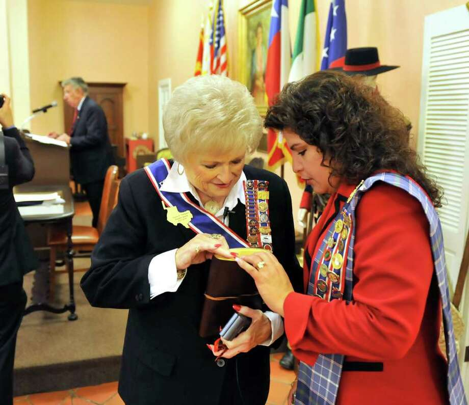 DRT President General Karen Thompson (left) and Melinda Navarro, Alamo Committee chairwoman, look over a copy of the March 1, 1700, report by Mexican Capt. Diego Ramón on the founding of Mission San Francisco Solano. The mission later was moved and re-established as Mission San Antonio de Valero, now known as the Alamo. Photo: Robin Jerstad, For The Express-News