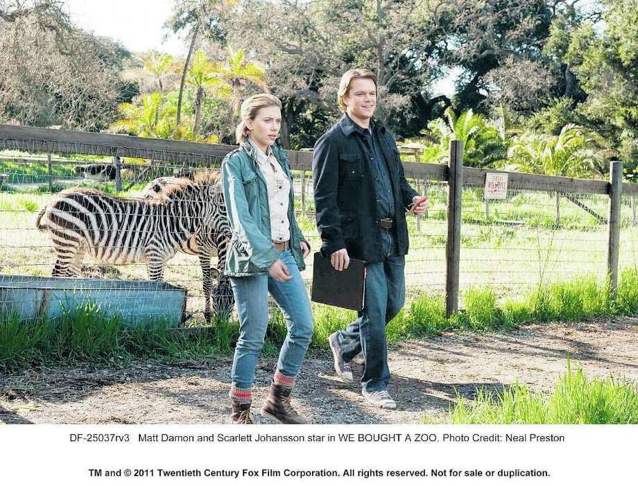 A HELPING HAND: Benjamin (Matt Damon) works to rehabilitate an animal preserve with the help of Kelly (Scarlett Johansson) in We Bought a Zoo. Photo: Neal Preston