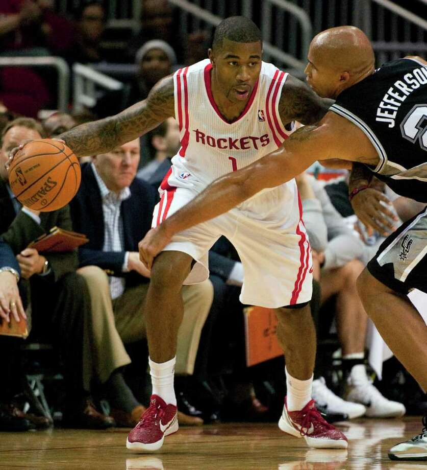 Houston Rockets' Terrence Williams (1) drives around San Antonio Spurs' Richard Jefferson (24) during the fourth quarter of a preseason NBA basketball game, Saturday, Dec. 17, 2011, in Houston. The Rockets defeated the Spurs 101-87. Photo: AP