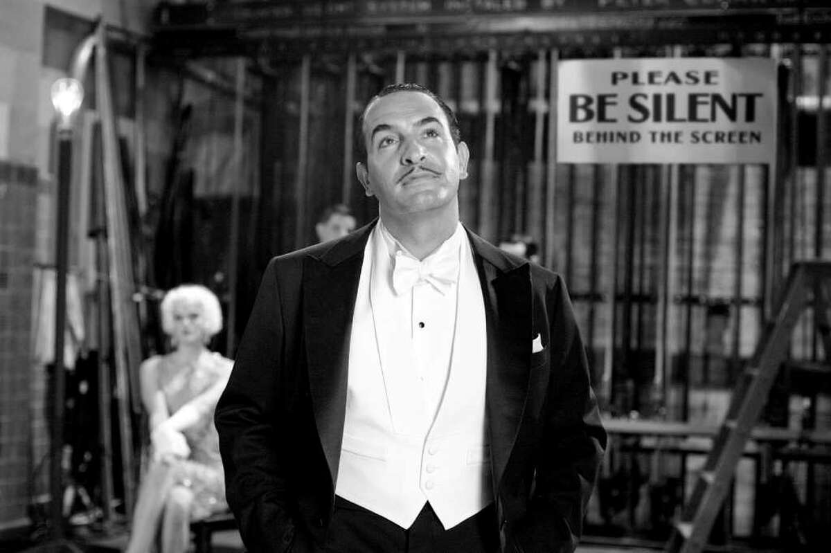 """Jean Dujardin, during a scene of the film """"The Artist,"""" in an undated handout image. """"The Artist"""" is a mostly silent movie with a musical soundtrack about an aging film idol, a peppy young actress and the passing of the silent-movie era. (Weinstein Company via The New York Times) -- NO SALES; FOR EDITORIAL USE ONLY WITH STORY SLUGGED ARTIST FILM REVIEW. ALL OTHER USE PROHIBITED. -"""