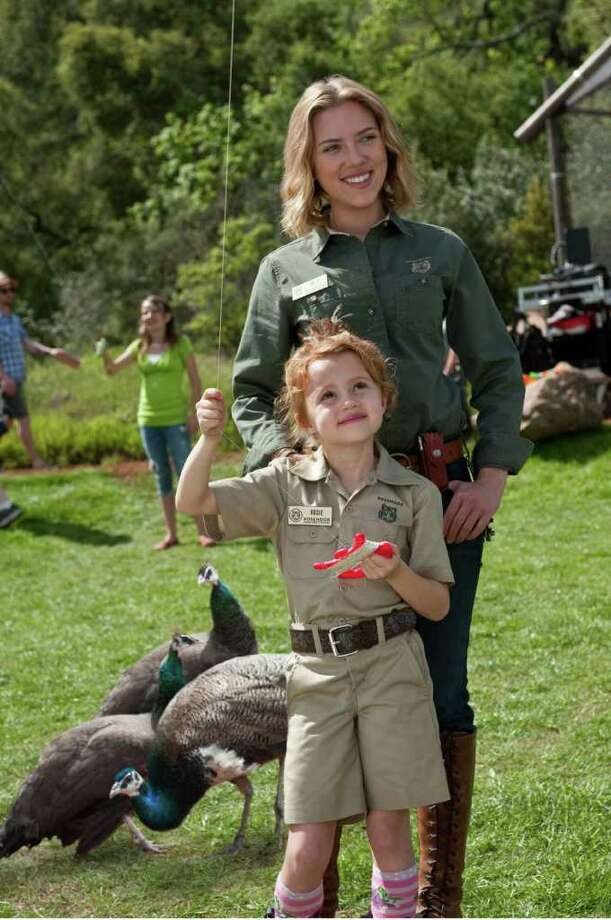 NEAL PRESTON : 20TH CENTURY FOX BONDING: Cameron Crowe ignored the old warning about making films with animals and kids for We Bought a Zoo, which co-stars Scarlett Johansson, rear, and Elizabeth Jones. Photo: Neal Preston / TM and © 2011 Twentieth Century Fox Film Corporation. All rights reserved. Not for sale or duplication.