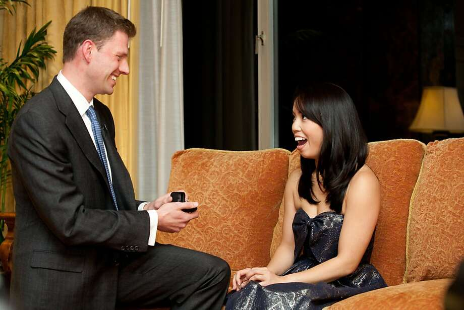 James Holder, 29, proposed to his girlfriend Jordan Lui, 27,  at San Francisco's Fairmont Hotel in November wit the help of the University of California Men's Octet. Photo: Kevin Chin Photography + Cinema, Www.KevinChin.com.