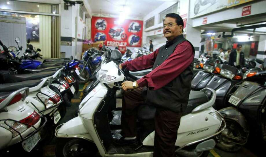 SAURABH DAS : ASSOCIATED PRESS  PROSPERING: Hari Kishan Pippal, 60, a member of India's outcast dalit community once known as untouchables, now has a firm grip on success in the nation's burgeoning middle class. In addition to his Honda dealership in Agra, Pippal now owns a hospital, a shoe factory and a publishing company, and resides in a quiet neighborhood marked by high walls and iron gates. Photo: Saurabh Das / AP