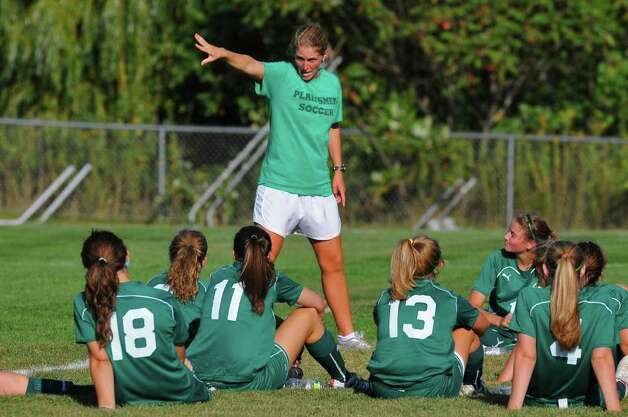 Shenendehowa head soccer coach Holli (cq) Mulholland talks to her team at halftime during Shen's 3-2  overtime win over Shaker in Latham, NY  on Tuesday September 7, 2010. ( Philip Kamrass / Times Union ) Photo: Philip Kamrass / 00010162A