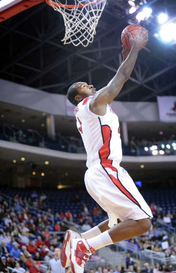 Fairfield's Yorel Hawkins dunks the ball during game action against Austin Peay at the Webster Bank Arena at Harbor Yard in Bridgeport, Conn. Saturday, Feb. 19, 2011. Photo: Autumn Driscoll / Connecticut Post