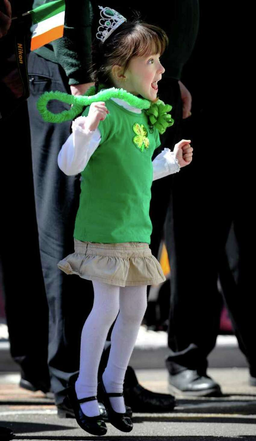 Four-year-old Paige Fabian, of Stratford, cheers as the St. Patrick's Day parade moves down Main Street in Bridgeport, Conn. Thursday, Mar. 17, 2011.