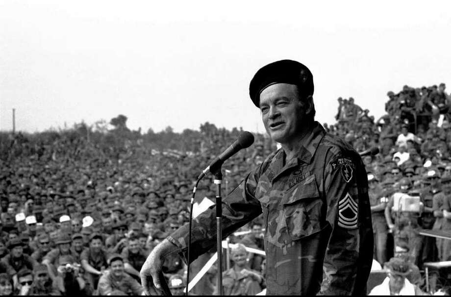 FILE--Comedian Bob Hope entertains troops at Cu Chu, 20 miles northwest of Saigon, Vietnam, in a Dec. 1970 file photo. Bob Hope, ski-nosed master of the one-liner and favorite comedian of servicemen and presidents alike, died Sunday, July 27, 2003, less than two months after turning 100. Photo: Associated Press File Photo / AP