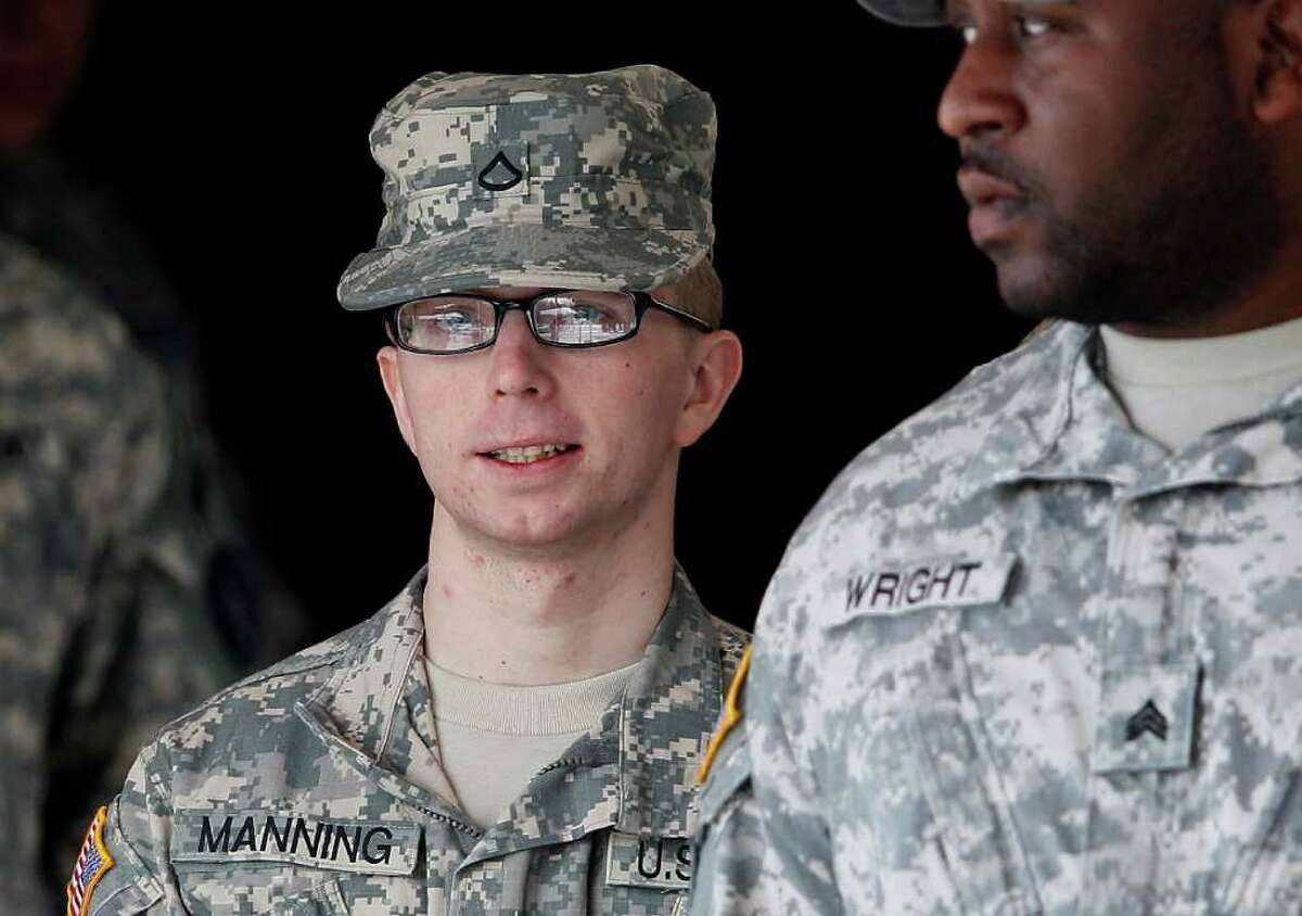 Army Pfc. Bradley Manning, left, is escorted from a courthouse in Fort Meade, Md., Thursday, Dec. 22, 2011, after closing arguments concluded in a military hearing that will determine if he should face court-martial for his alleged role in the WikiLeaks classified leaks case. (AP Photo/Patrick Semansky)