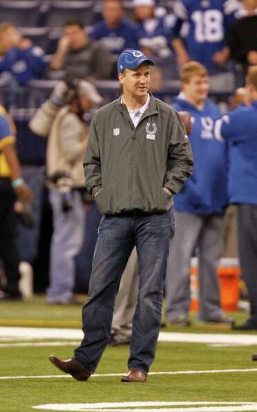 Indianapolis Colts' Peyton Manning waits for the start of an NFL football game against the Houston T
