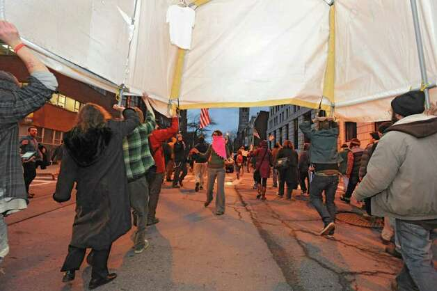 Occupy Albany members march through Albany with the last tent from Academy Park on Thursday, Dec. 22, 2011 in Albany, N.Y.  (Lori Van Buren / Times Union) Photo: Lori Van Buren
