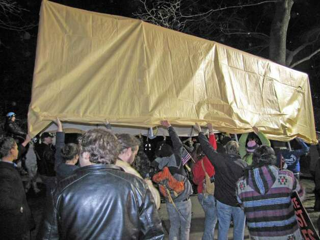A tent is carried aloft at the Occupy Albany protest site (Phoebe Sheehan / Special to the Times Union)