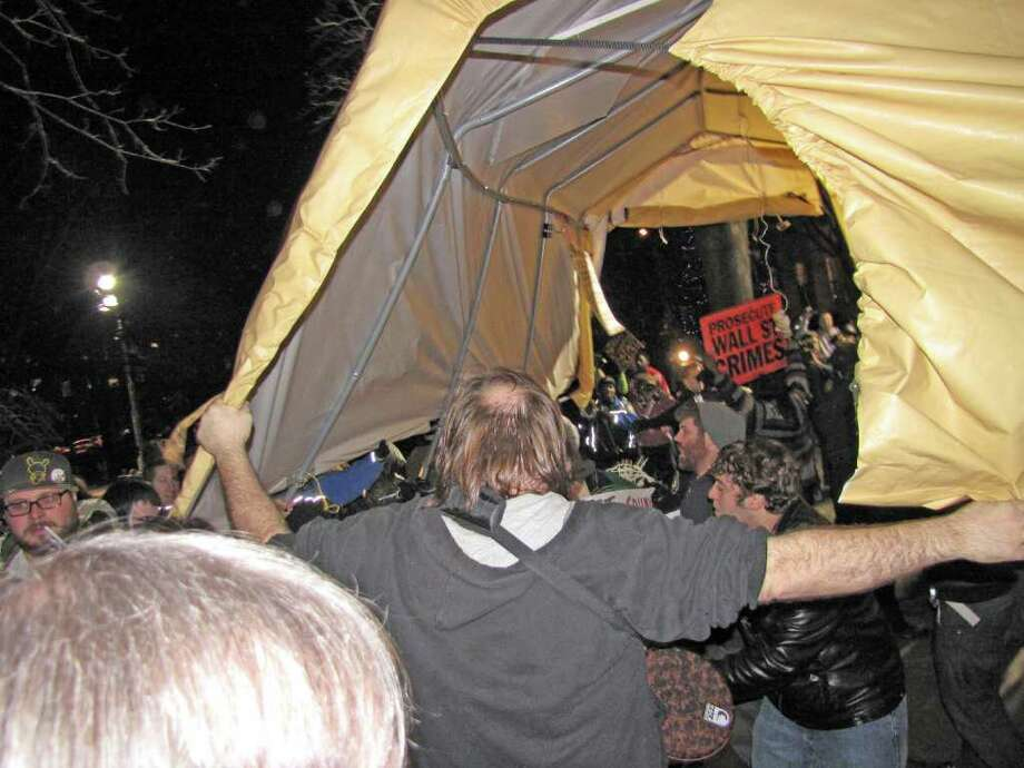 A tent is carried aloft at the Occupy Albany protest site. (Phoebe Sheehan / Special to the Times Union)