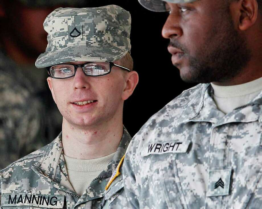 Army Pfc. Bradley Manning, left, is escorted from a courthouse in Fort Meade, Md., Thursday, Dec. 22, 2011, after closing arguments concluded in a military hearing that will determine if he should face court-martial for his alleged role in the WikiLeaks classified leaks case. (AP Photo/Patrick Semansky) Photo: Patrick Semansky