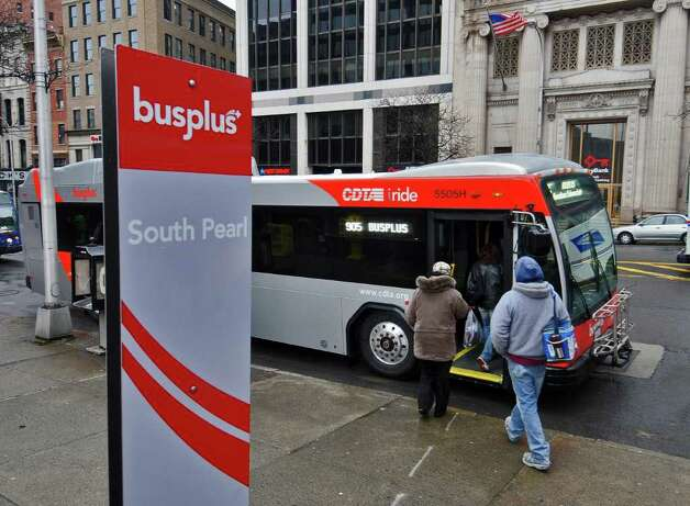 Passengers board a BusPlus bus at a stop on State Street  at South Pearl Street on Monday April 4, 2011 in Albany, NY.  CDTA inaugurated the service on Monday. (Philip Kamrass/ Times Union ) Photo: Philip Kamrass / 00012633A