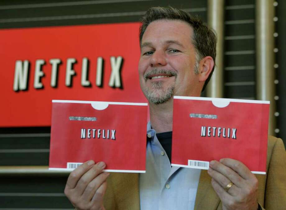 Paul Sakuma : Associated Press File XXXXX: In this May 16, 2008 file photo, Netflix CEO Reed Hastings smiles at Netflix headquarters in Los Gatos, Calif.  Netflix will release its quarterly earnings report after the market close Monday, Oct. 20, 2008. (AP Photo/Paul Sakuma, file) Photo: Paul Sakuma / AP
