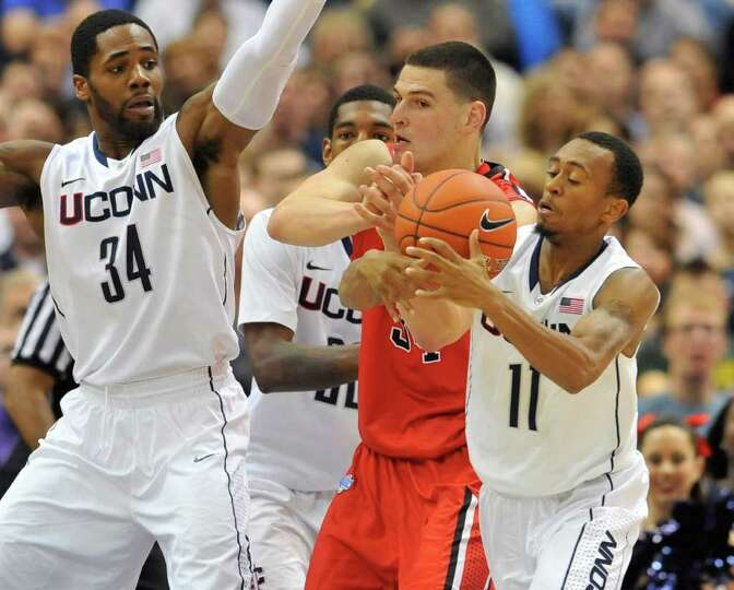 Connecticut's Ryan Boatright (11) steals the ball from Fairfield's Ryan Olander, center, as Connecti