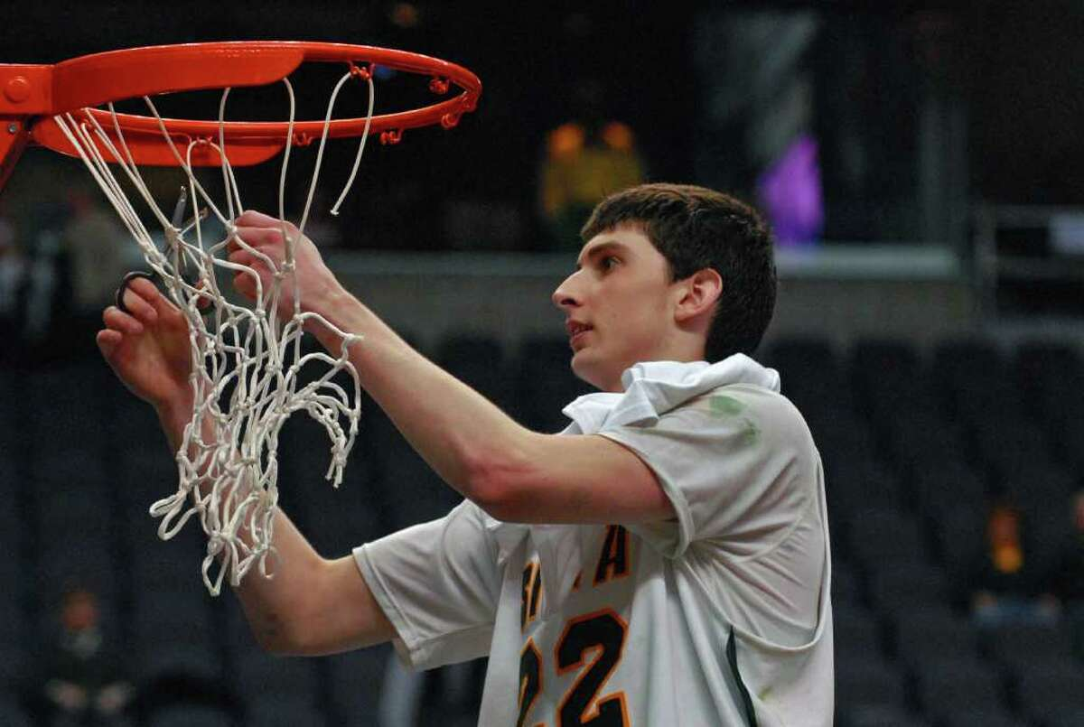 Siena player Ryan Rossiter helped set the school record of 15 straight wins in 2010, but is rooting for the current Siena team to break the mark. (Philip Kamrass / Times Union)