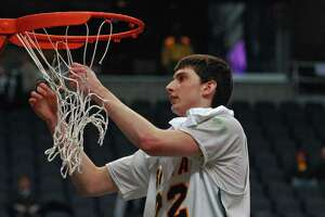 Siena's Ryan Rossiter cuts down part of the net after their 77-70 victory over Niagara in the MAAC Tournament final  at the Times Union Arena in Albany, NY on Monday March 9, 2009.  (Philip Kamrass / Times Union)