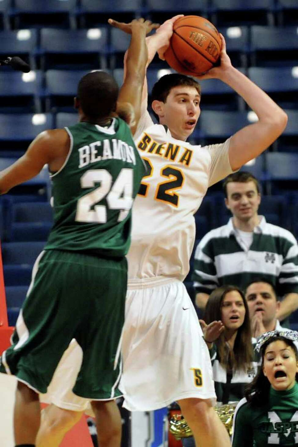 Siena's Ryan Rossiter (22), right, grabs the rebound over Manhattan's George Beamon (24) during their basketball game at the MAAC Championships on Friday, March 4, 2011, at Webster Band Arena at Harbor Yard in Bridgeport, Conn. (Cindy Schultz / Times Union)
