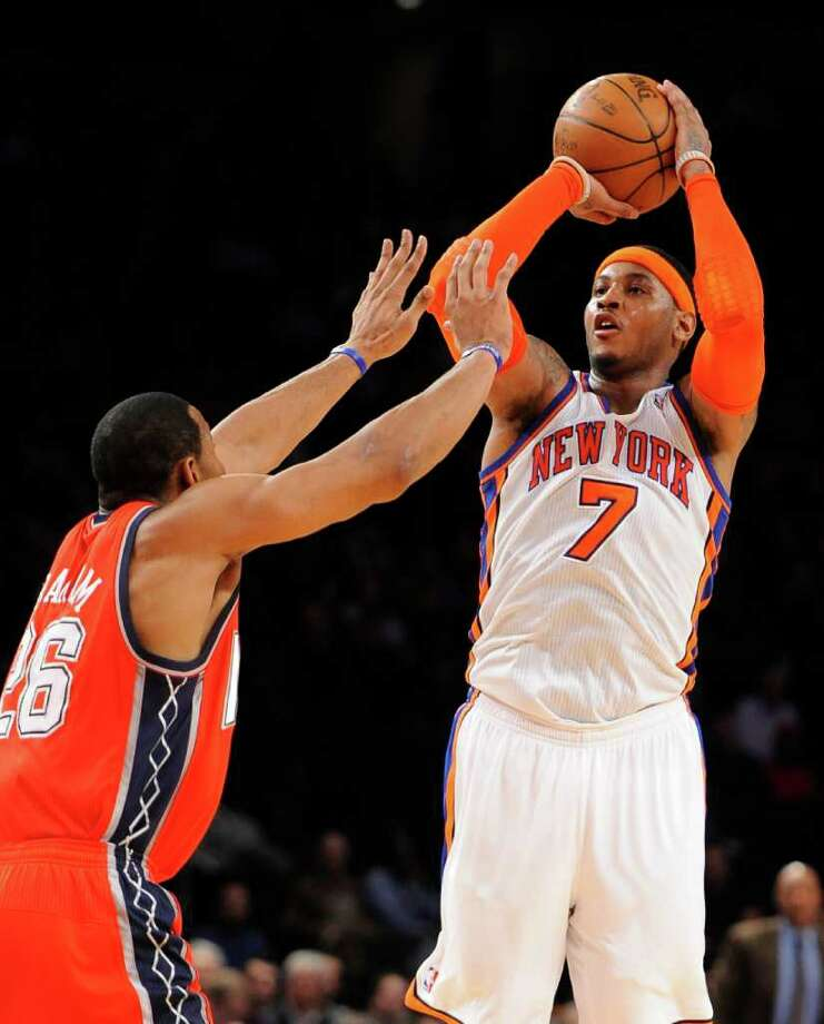 New York Knicks' Carmelo Anthony (7) shoots over New Jersey Nets' Stephen Graham (26) during the first half of an NBA preseason basketball game, Wednesday, Dec. 21, 2011, in New York. (AP Photo/Kathy Kmonicek) Photo: Kathy Kmonicek